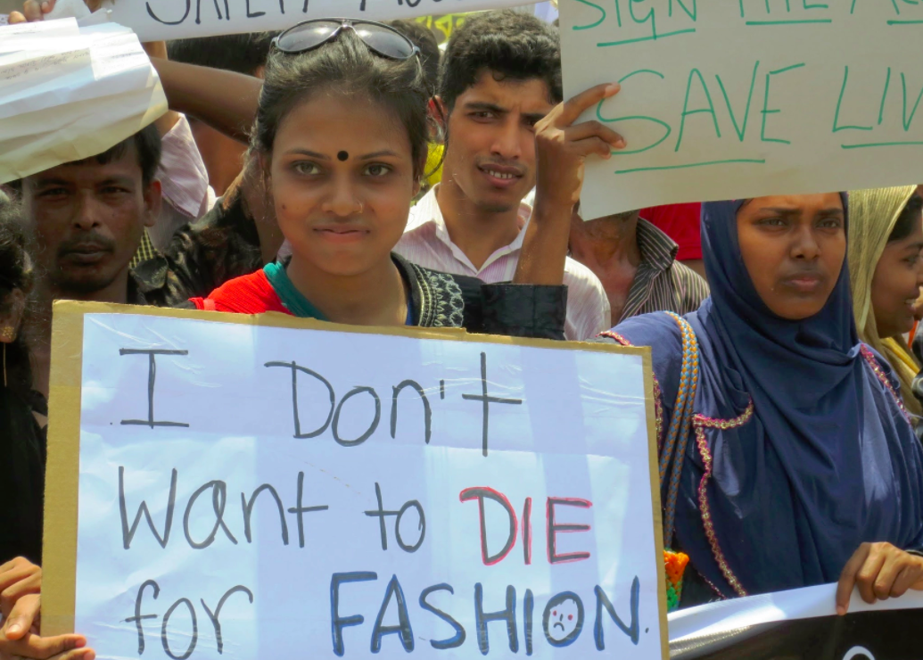 A young woman protests garment worker deaths in Bangladesh